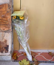 Flowers and a card sit propped against an entryway at Temple Beth Israel in York, Monday, October 29, 2018. 