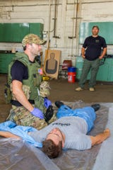 UPMC trauma doctor, Keith Murray, works during a drill with the Pittsburgh SWAT team.