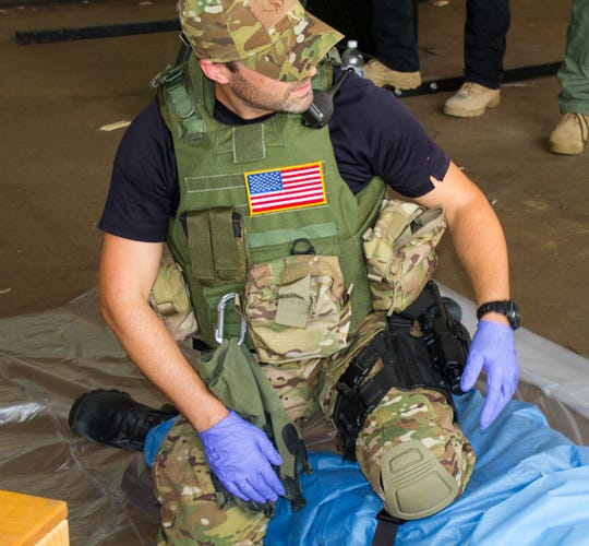 UPMC trauma doctor, Keith Murray, trains during a Pittsburgh SWAT team drill.