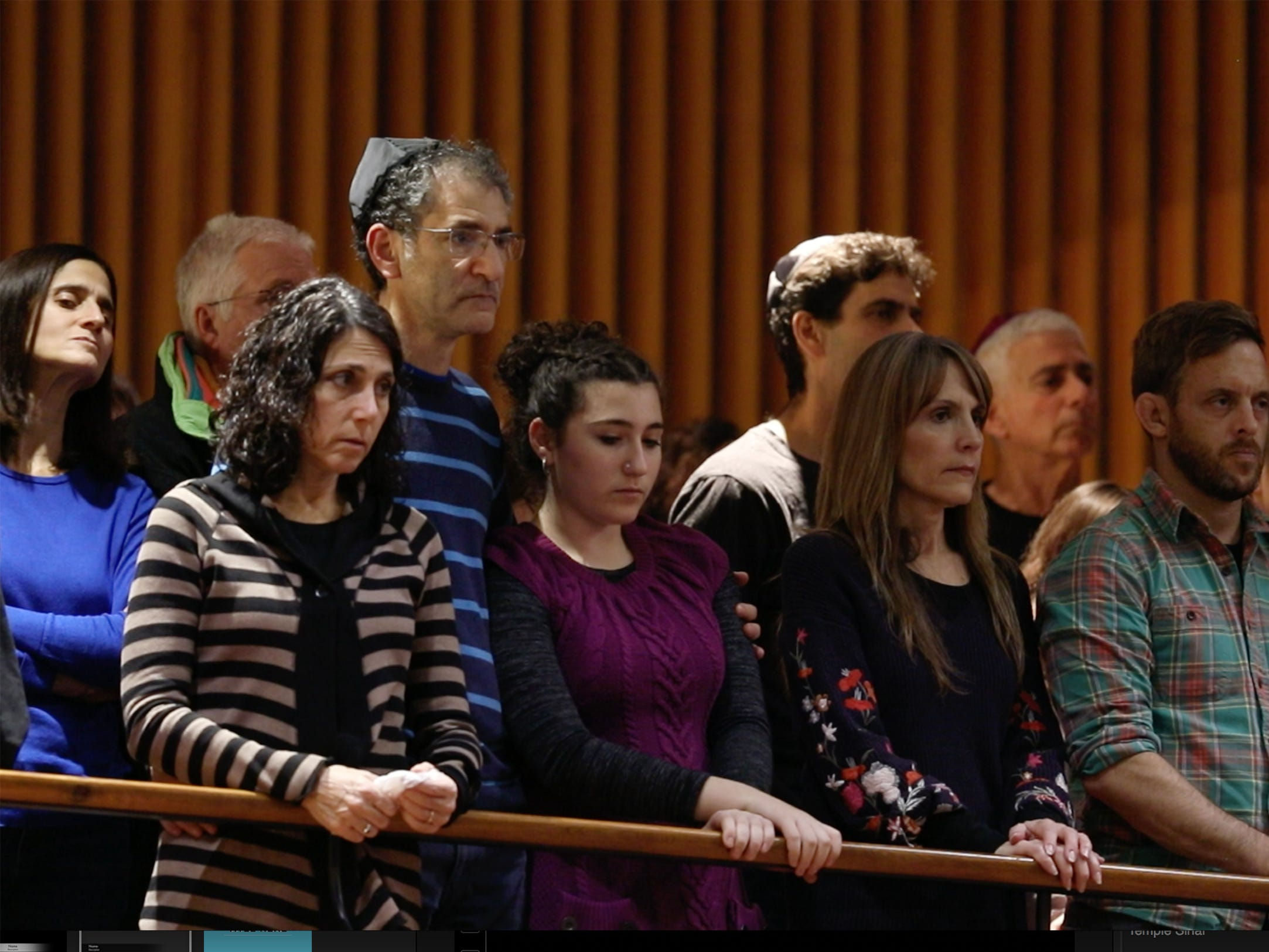 People rise for the Kaddish for the victims of the Pittsburgh synagogue shooting.
