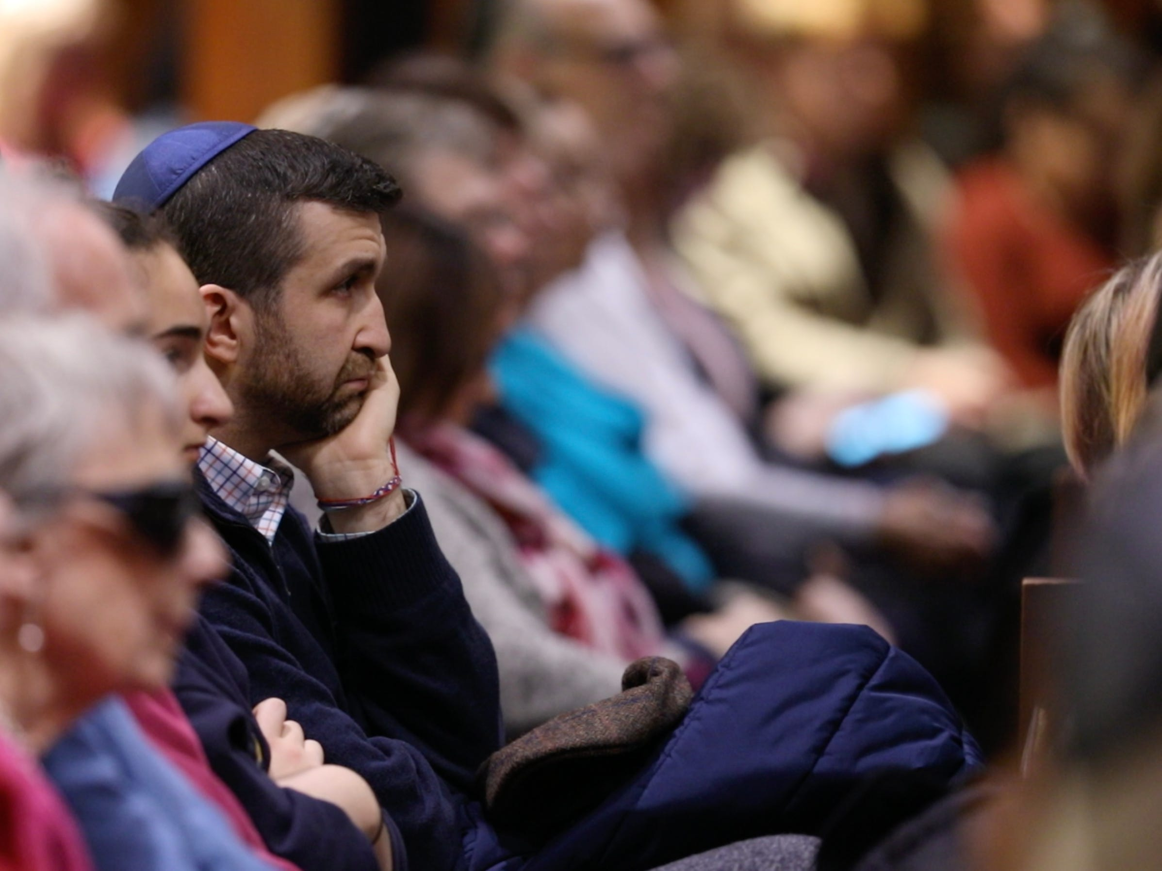 A standing-room crowd gathers in support of those who died in the fatal shooting at a Pittsburgh synagogue.