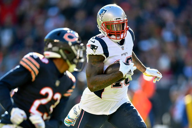 New England Patriots wide receiver Josh Gordon (10) runs with the ball against Chicago Bears cornerback Kyle Fuller (23) at Soldier Field.