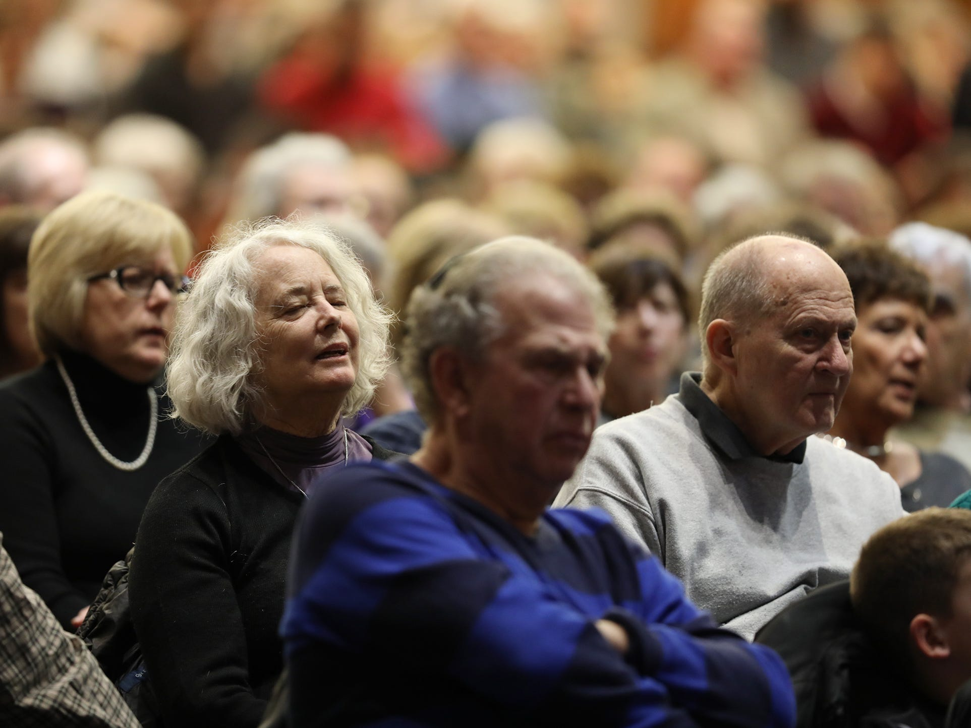 A large number of people came to the community vigil at Temple B'rith Kodesh in response to the shootings at a synagogue in Pittsburgh that killed 11 and injured others Saturday.
