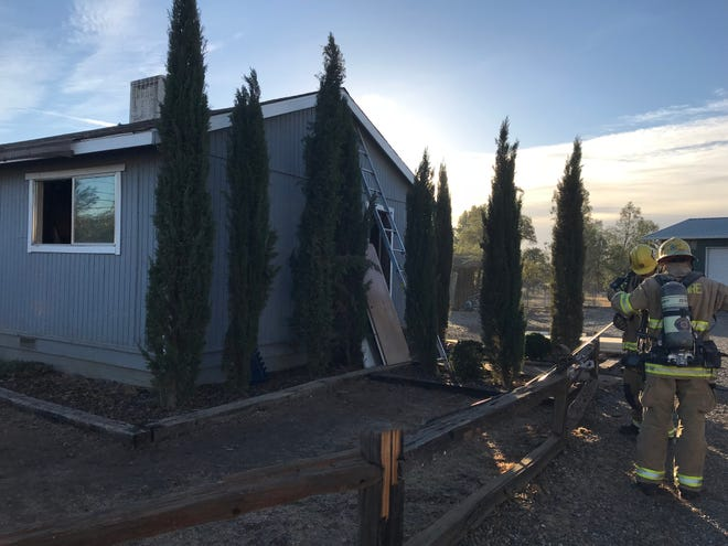 A fire that started in a bathroom and spread to the attic caused an estimated $10,000 to $15,000 damage Monday to an east Redding area home.