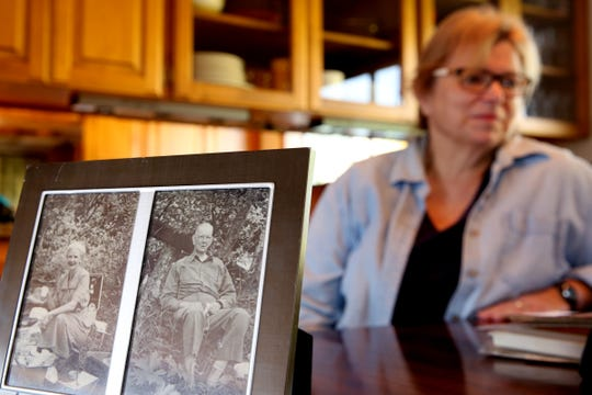 Sue Baker looks over letters written by her grandfather, Carle Abrams, to her grandmother during WWI, including one written on the last day of the war, at her West Salem home on Monday, Oct. 29, 2018.