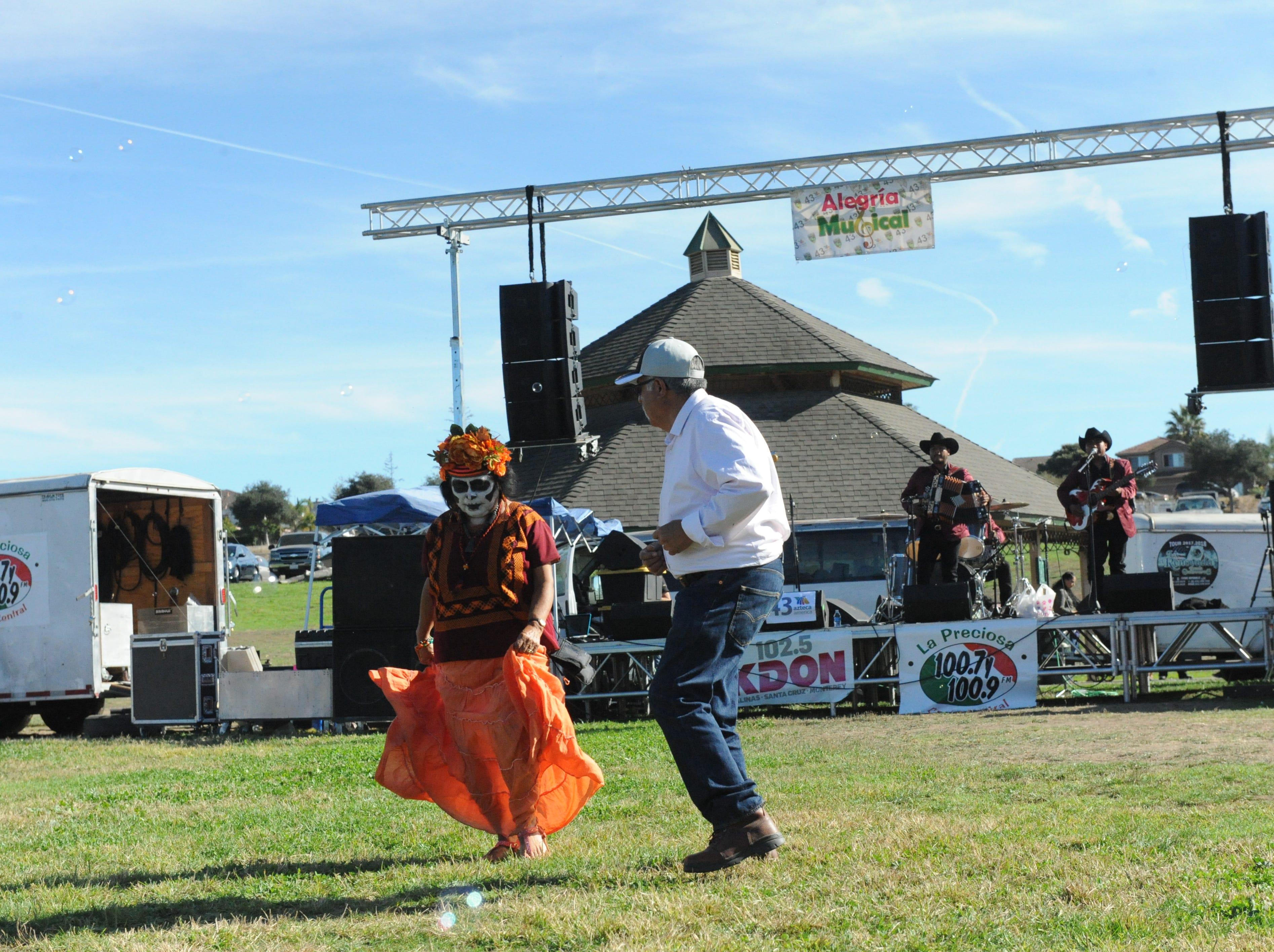 Jose and Maria Luisa Covarrubias dance at Sunday's Día de los Muertos celebration at Natividad Creek Park.