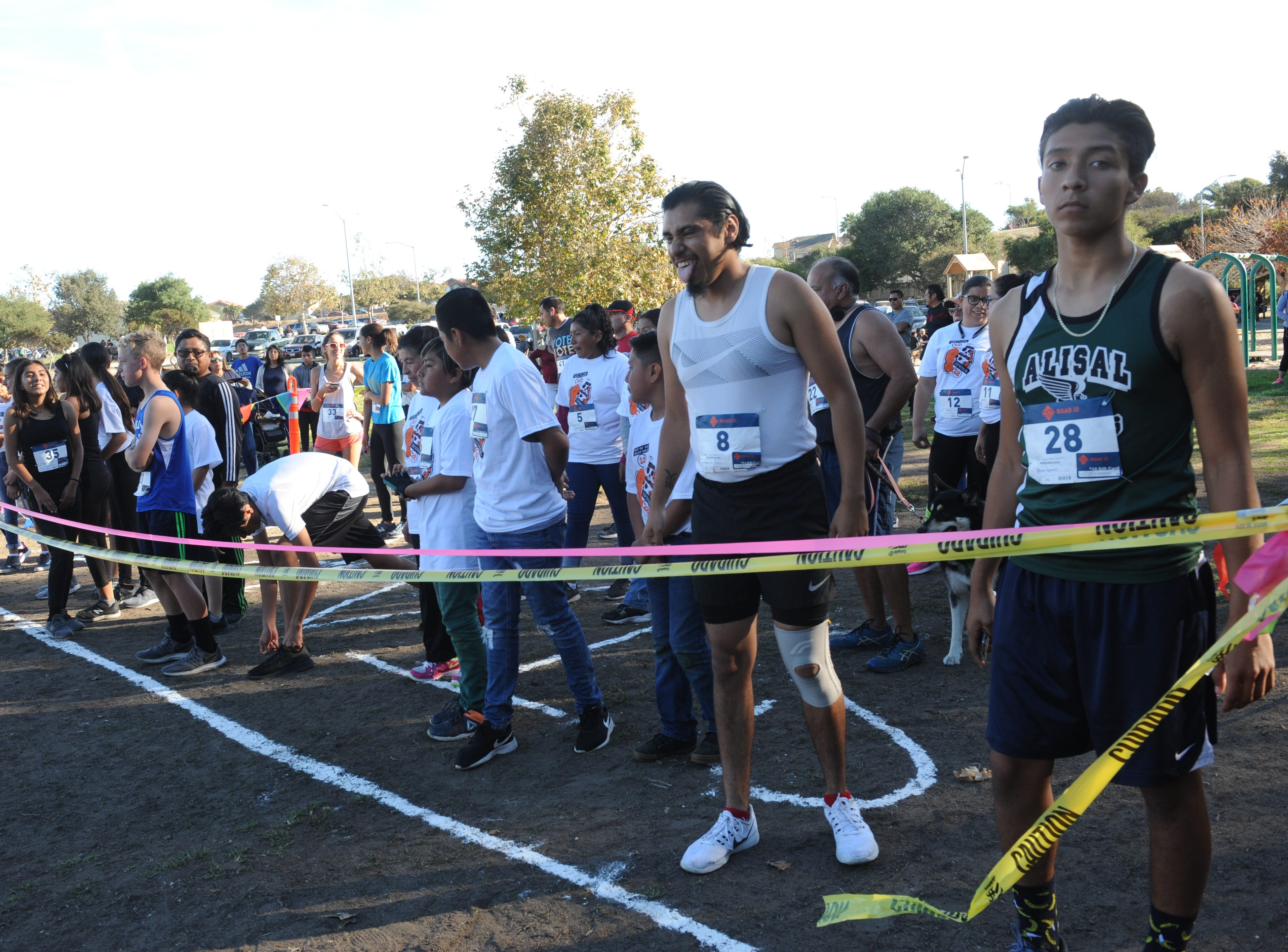 Runners get set for the Día de los Muertos benefit 5K run, which took place at Natividad Creek Park on Sunday.