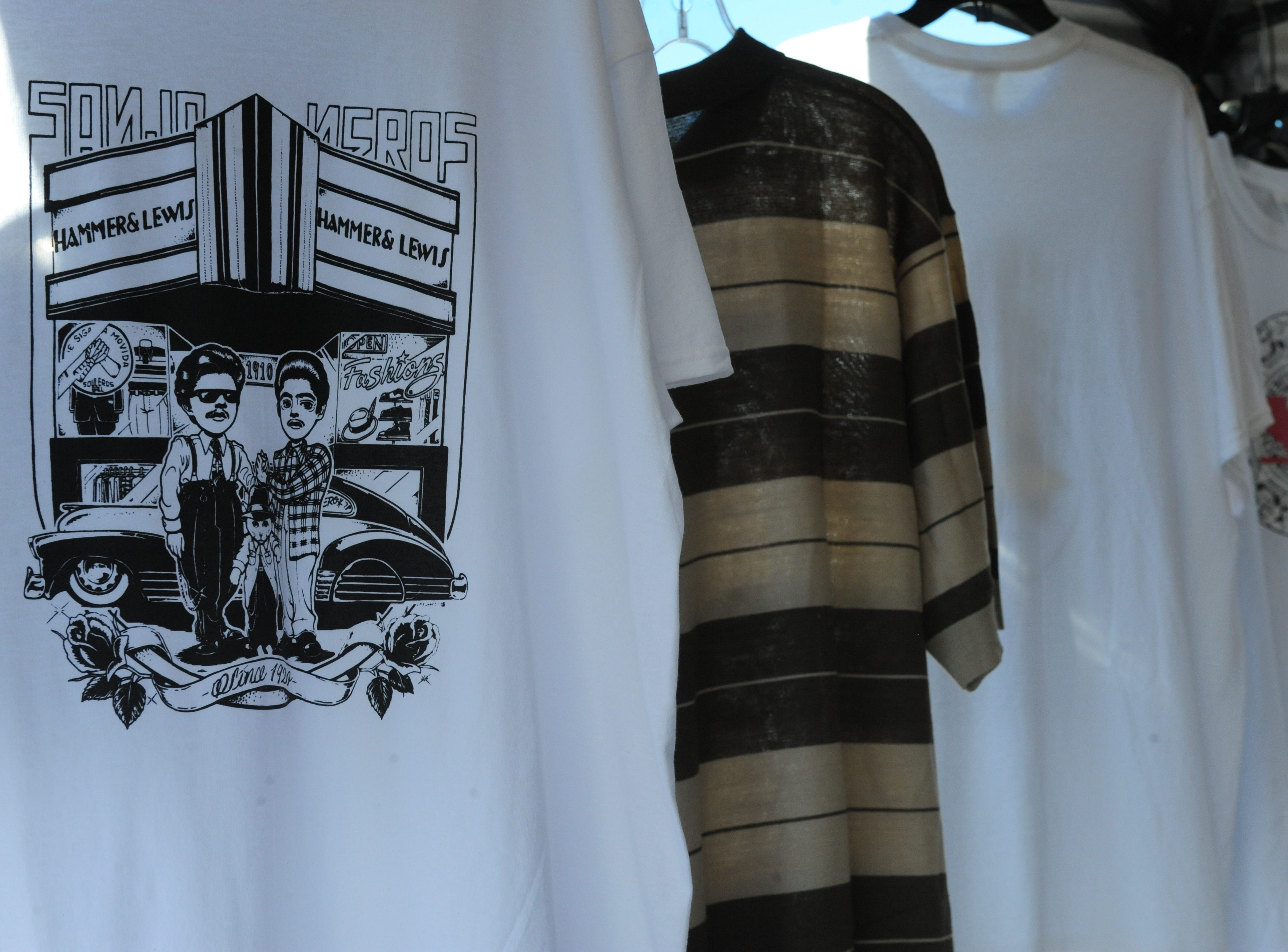 Shirts from Hammer & Lewis, of San Jose, that were for sale at Sunday's Día de los Muertos event.