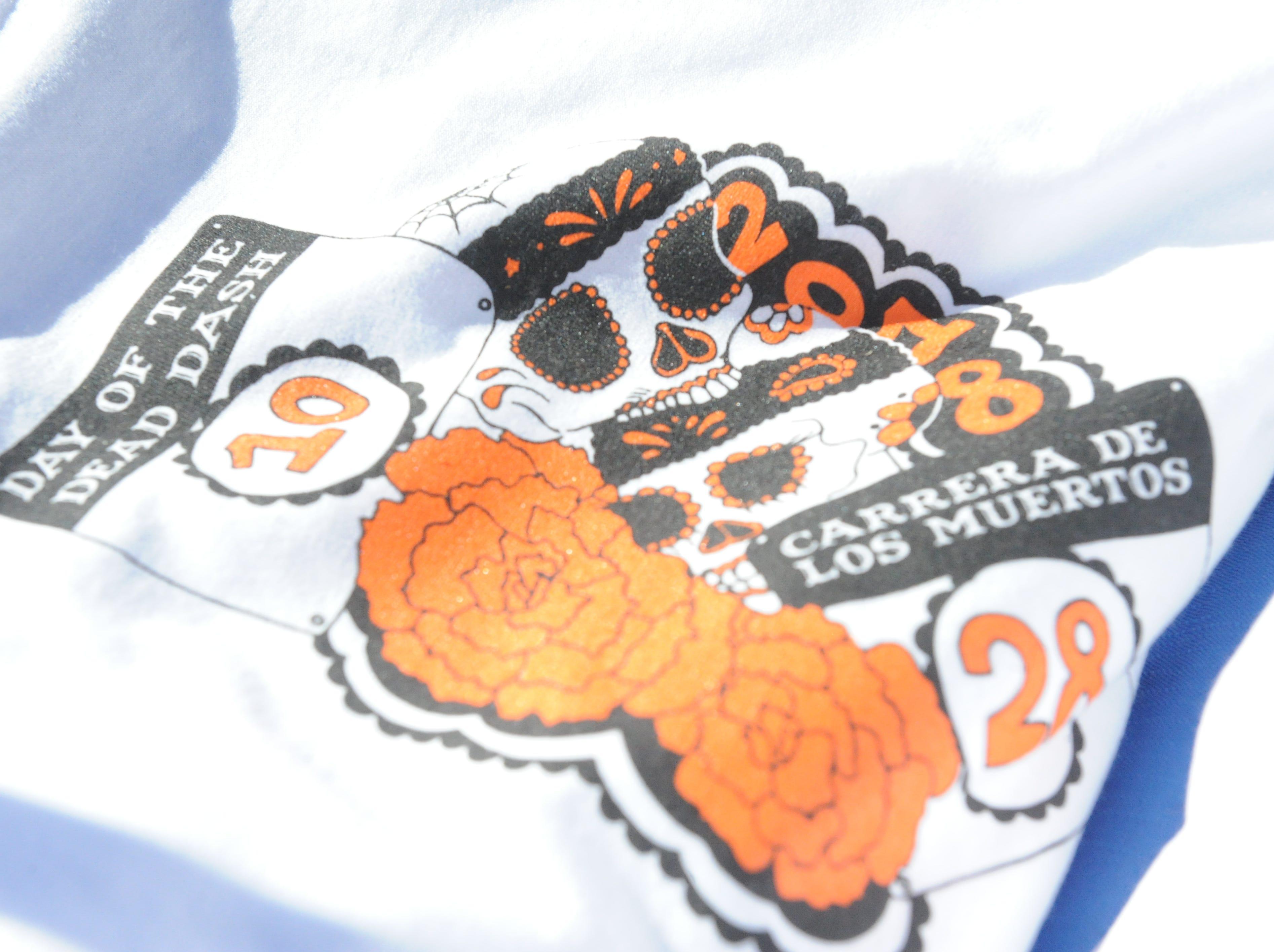 The event t-shirt for the Día de los Muertos 5k run.