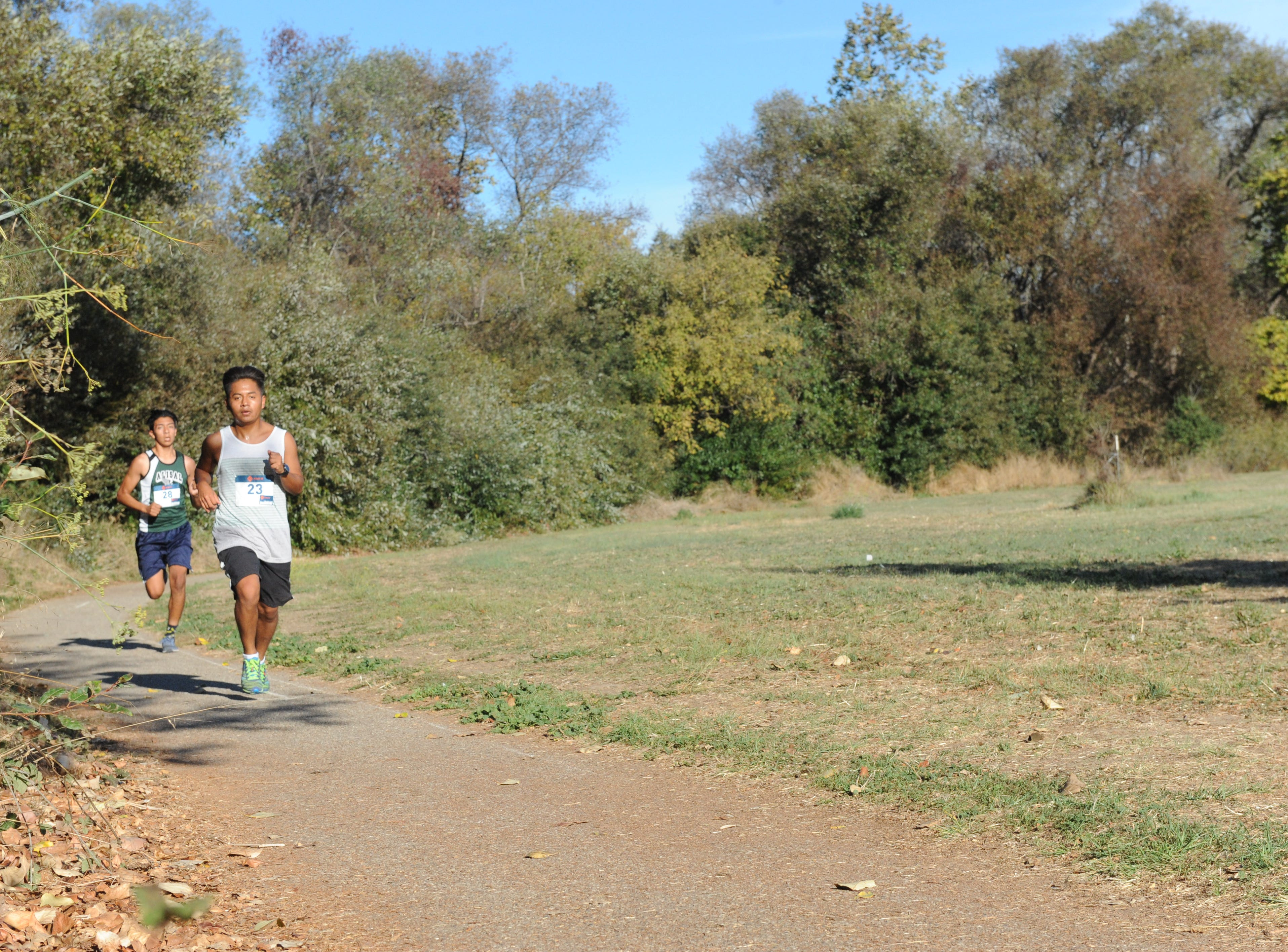 Paul Lazaro, 22, won Sunday's Día de los Muertos race, while Bryan Gomez, 16, placed second.
