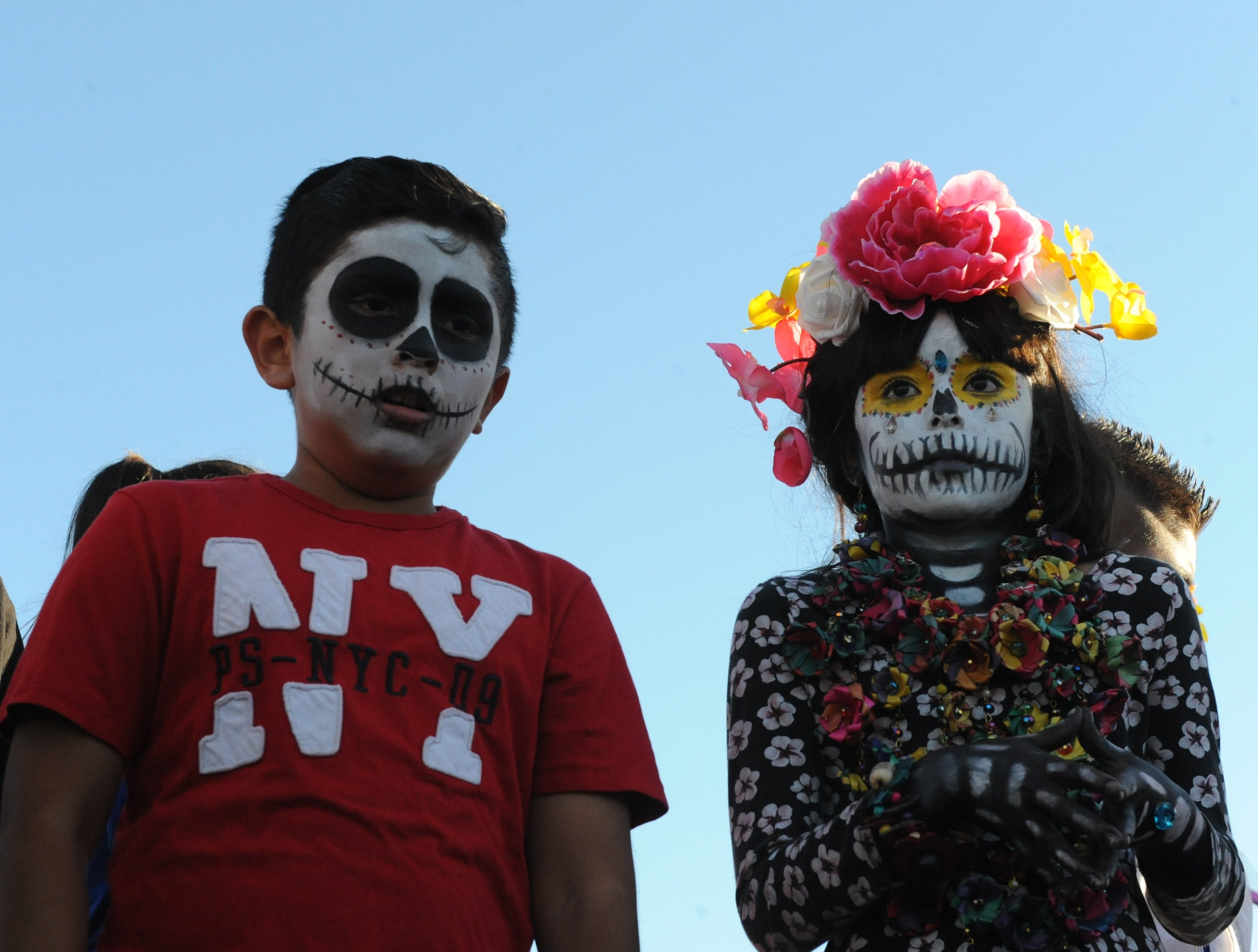 "Angela Ocegueda, right, wearing flowers and in face paint, was the winner of the Día de los Muertos' La Calavera Catrina, or ""The Elegant Skeleton,"" contest in Salinas on Sunday."