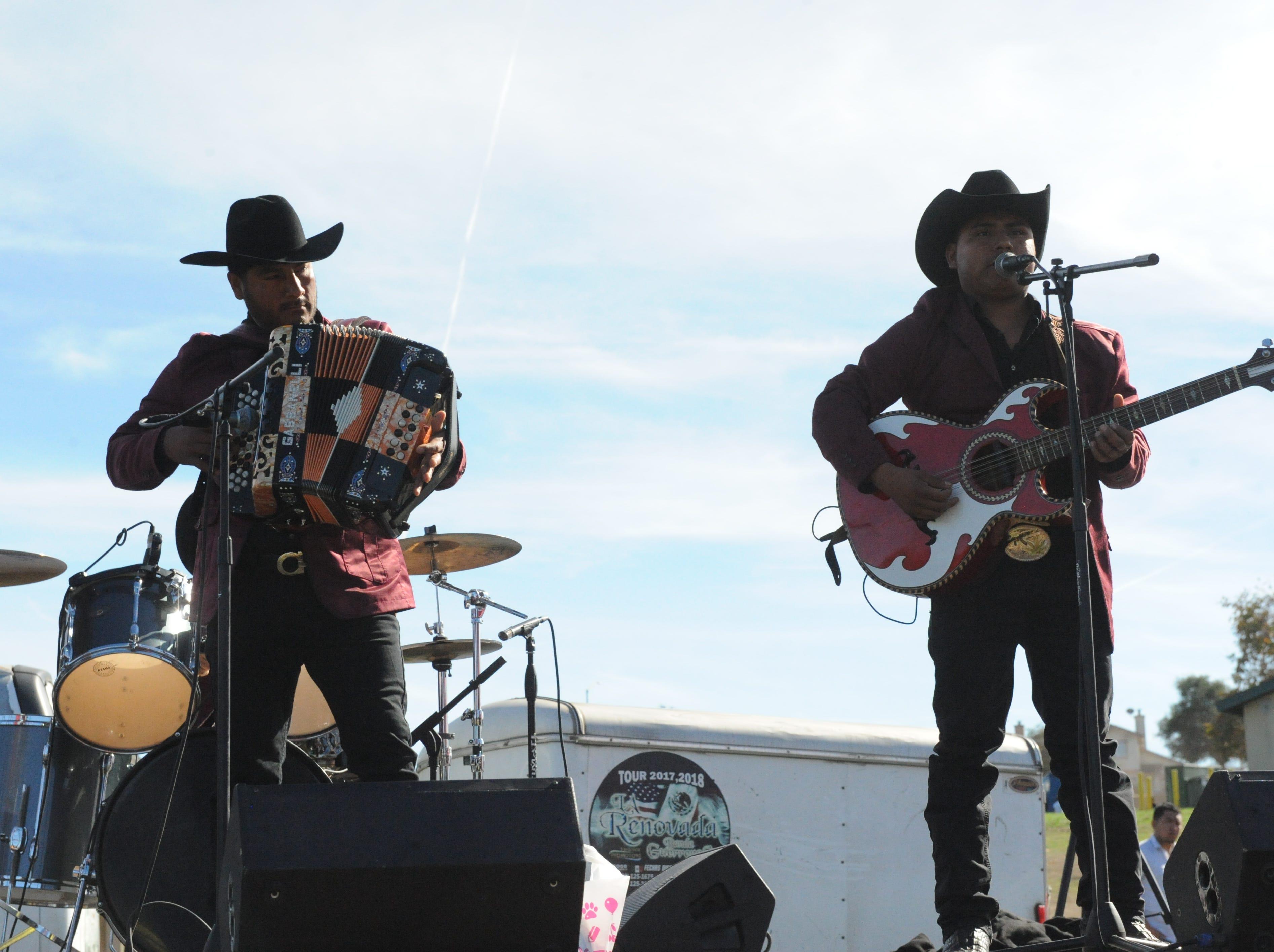 Los Nuevos Austeros, a musical group from Salinas, performs at the Día de los Muertos celebration on Sunday at Natividad Creek Park.