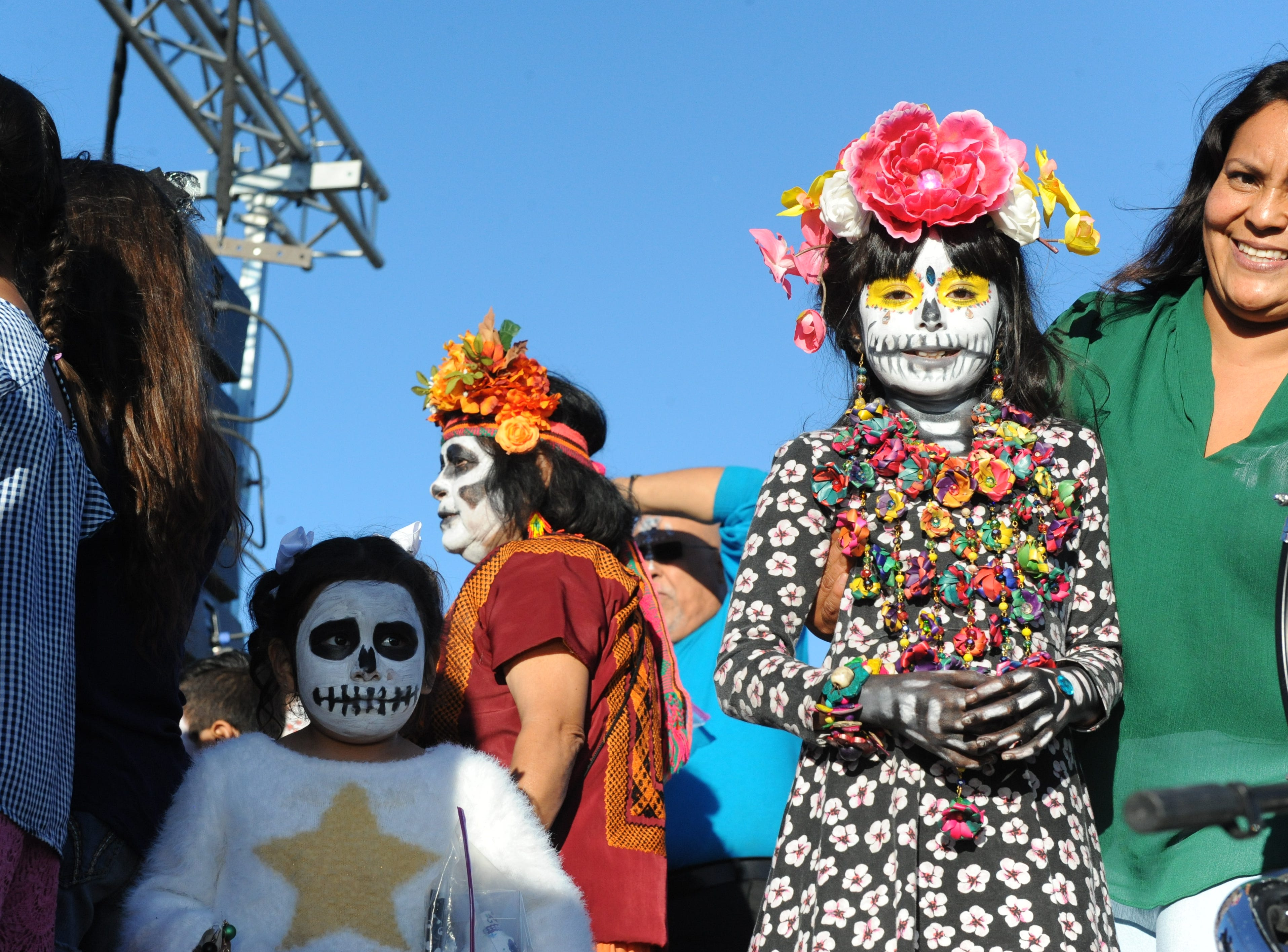 """Angela Ocegueda, wearing flowers and in face paint, was the winner of the Día de los Muertos' La Calavera Catrina, or """"The Elegant Skeleton,"""" contest in Salinas on Sunday."""