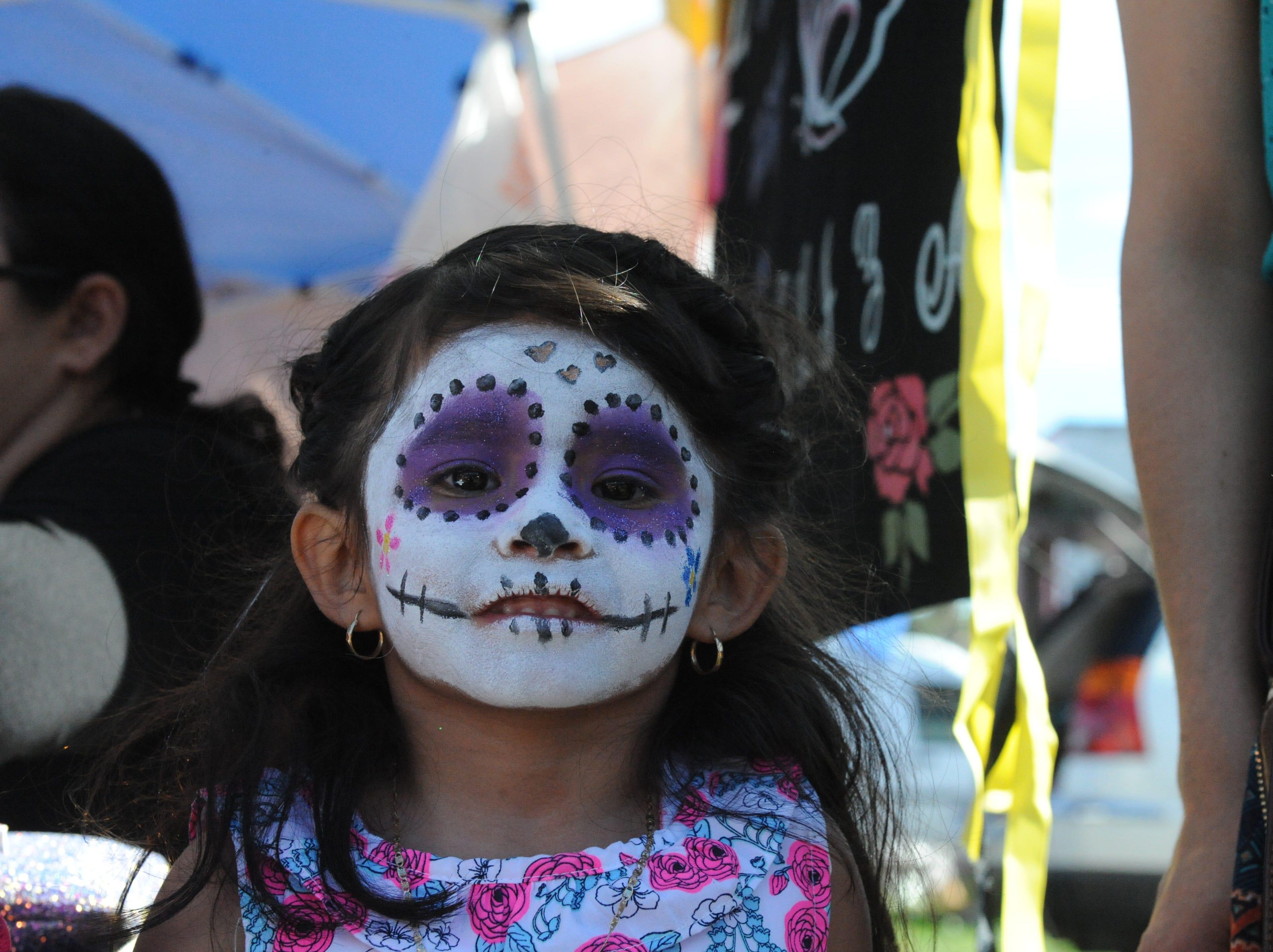 "Renata Paz Perez poses with her face painted in the image of La Calavera Catrina, or ""The Elegant Skeleton,"" at Sunday's Día de los Muertos celebration in Salinas."