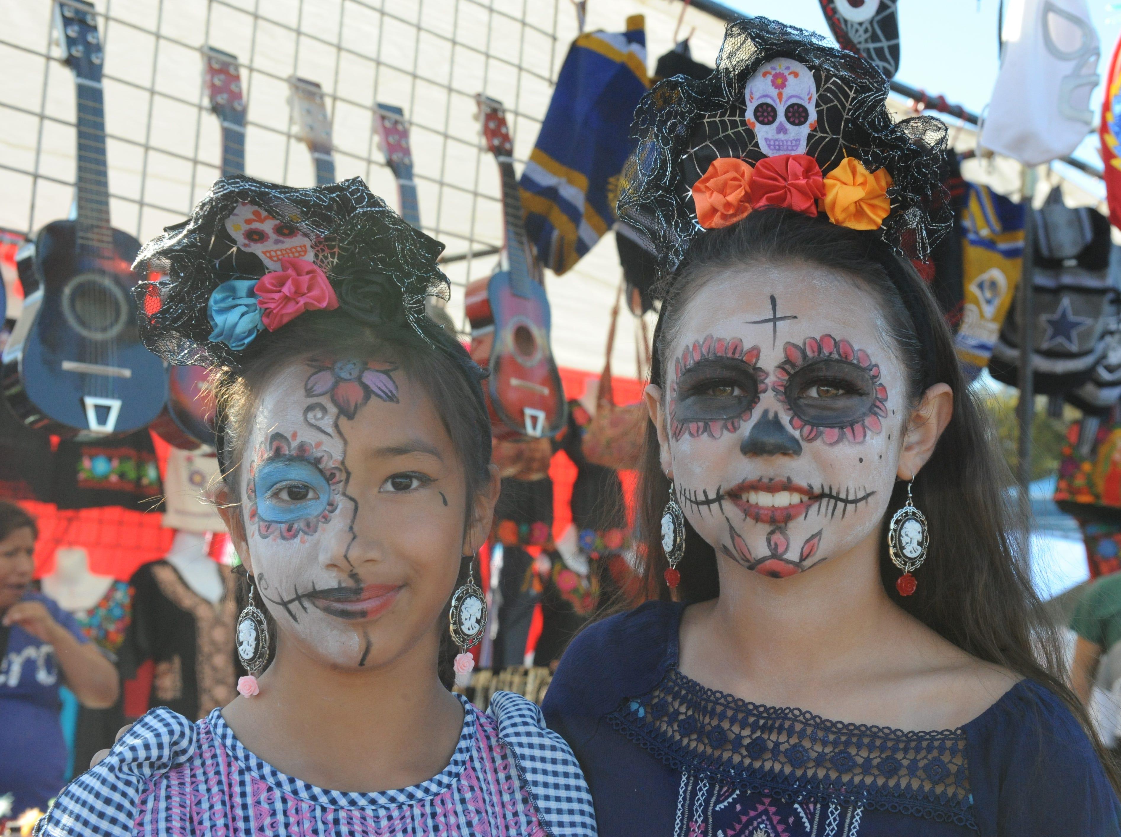 Salinas residents Sheyla Cerda and Lilly Gonzalez had their makeup done by Carlos Gonzalez in preparation for Sunday's Día de los Muertos celebration in Salinas.