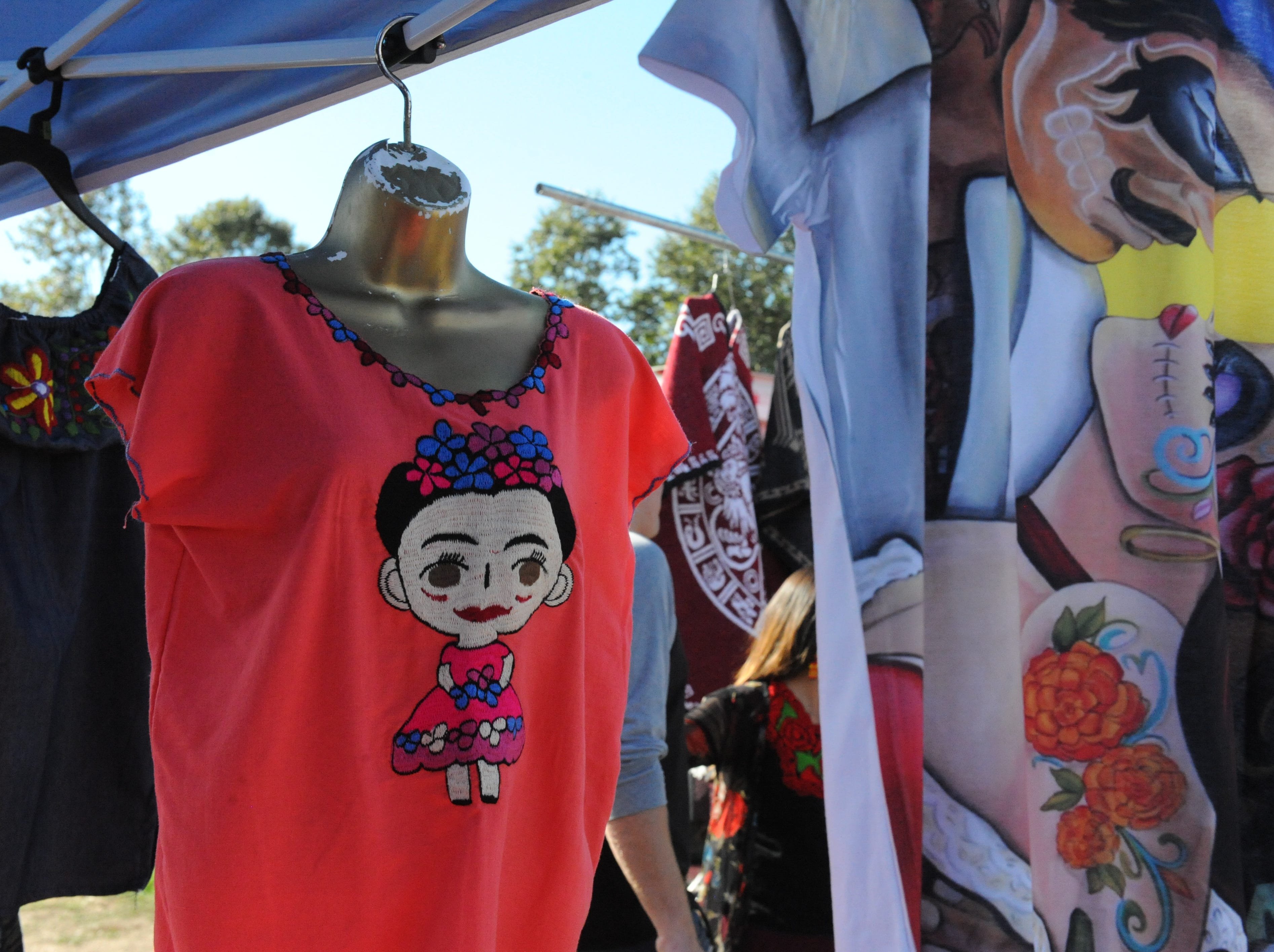 A Mexican blouse with the cartoon image of Frida Kahlo for sale by Sandy's of Watsonville at Sunday's Día de los Muertos celebration in Salinas.