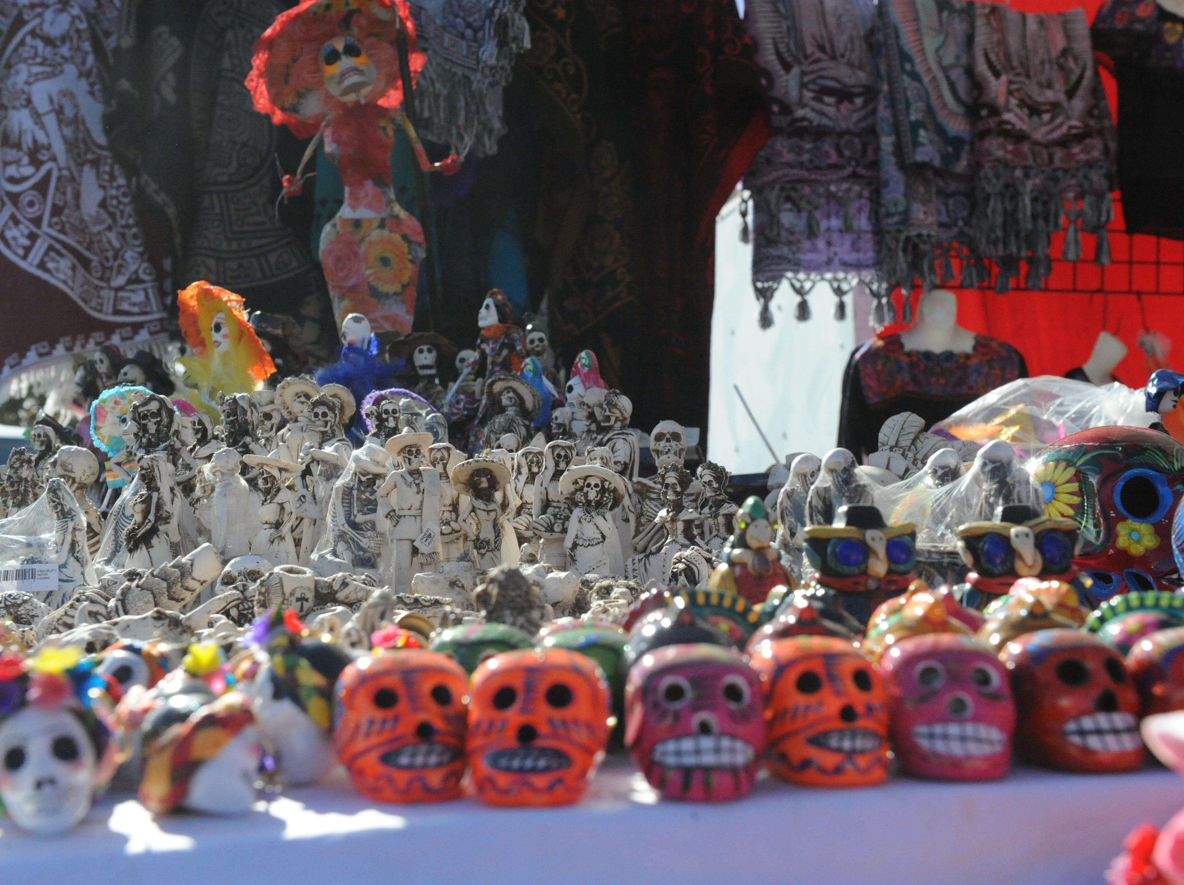 Skeleton decorations for sale by Curios Oaxaca of Bakersfield at Sunday's Día de los Muertos celebration in Salinas.