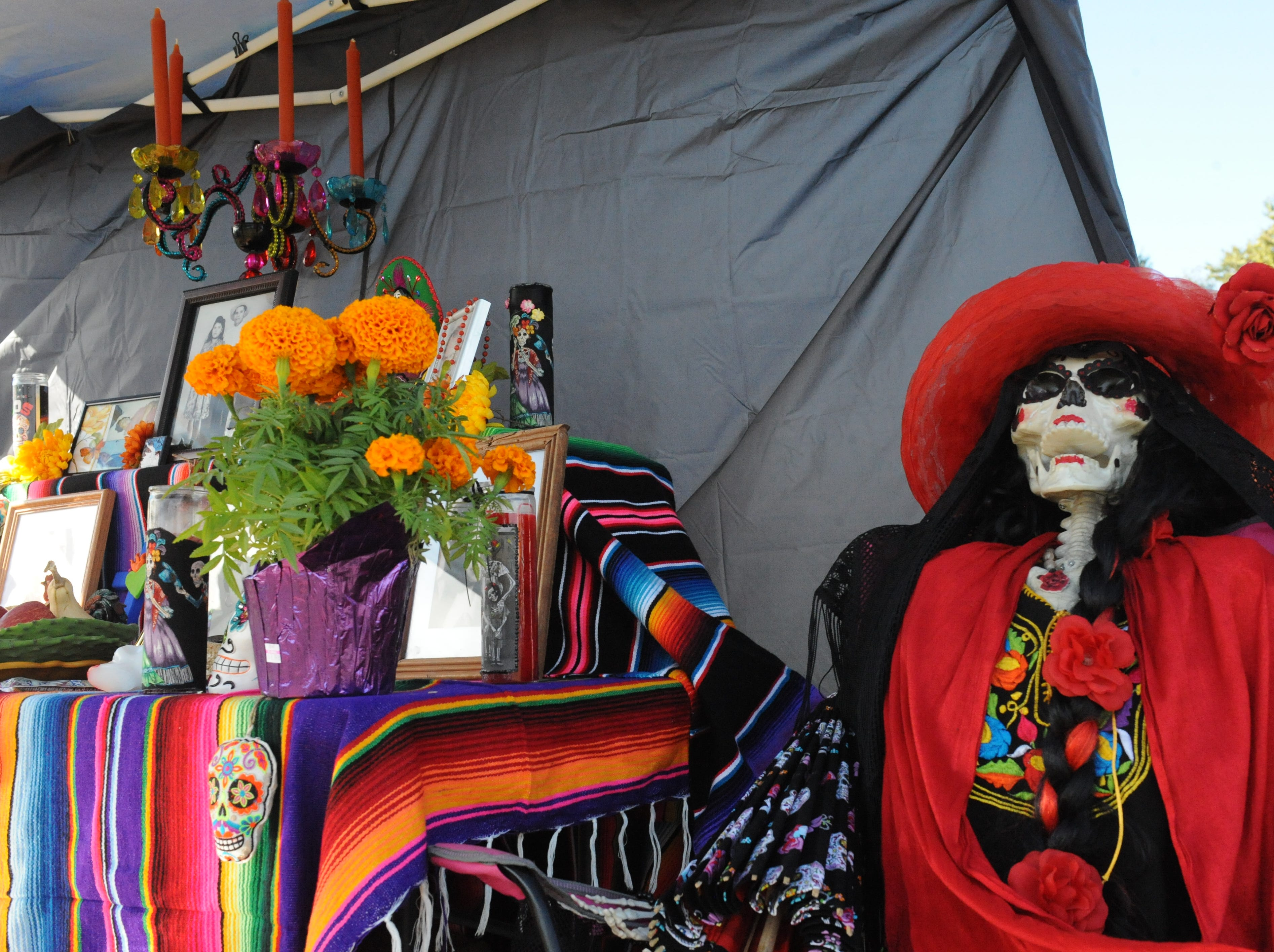 An altar for loved ones who have passed of Jose and Maria Luisa Covarrubias at Sunday's Día de los Muertos celebration at Natividad Creek Park.
