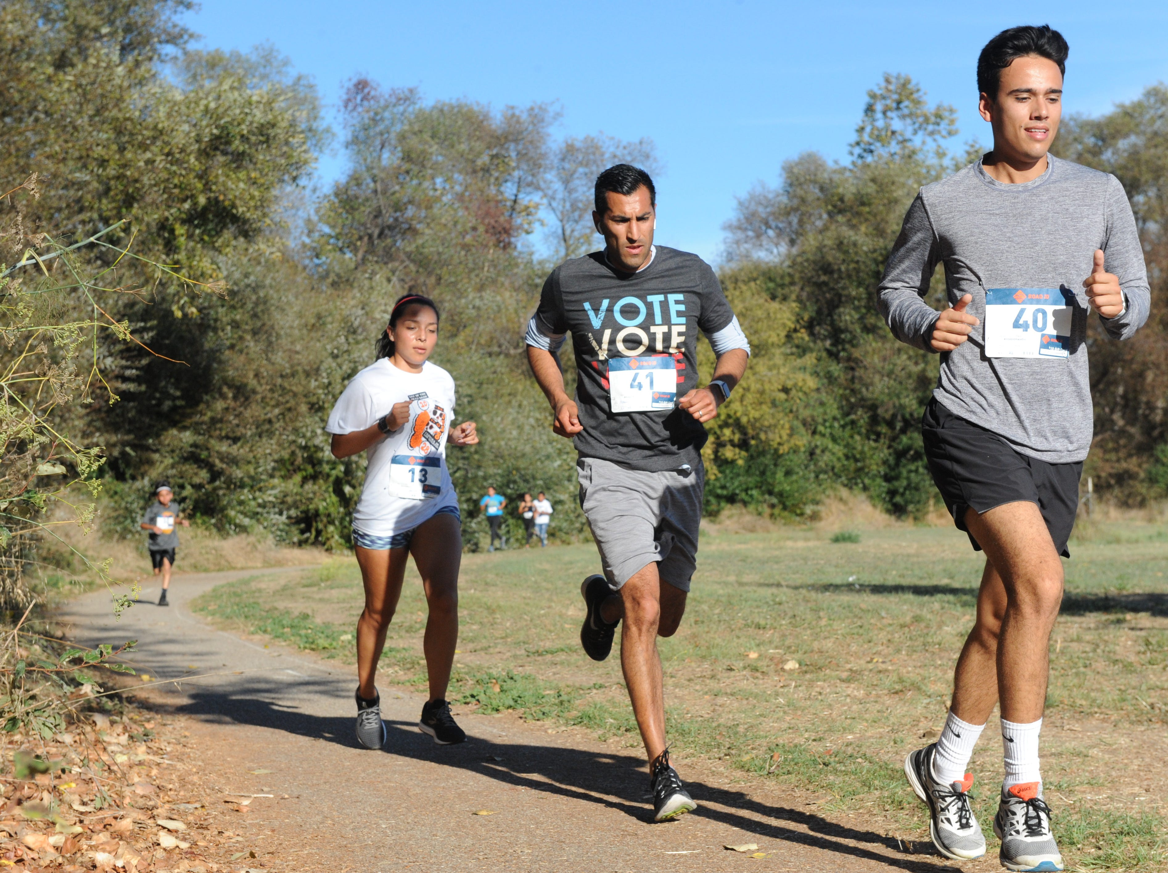 In the middle, Robert Rivas, San Benito County supervisor and state Assembly candidate, runs at Sunday's Día de los  Muertos 5k benefit run.