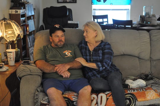 Kenny Watts his girlfriend, Tricia Sulecki,  sit in Watts' living room at his home in Greenwood, Delaware on Oct. 24, 2018.