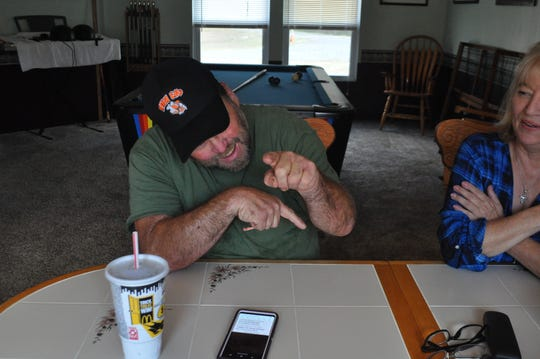 Kenny Watts shows how he can point his index finger on his left hand -- something he expected he would never be able to do again after being infected with Vibrio vulnificus in 2017.