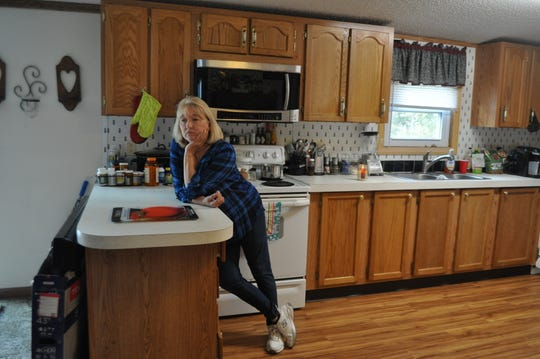 Tricia Sulecki, Watts' girlfriend of 17 years, stands in Watts' kitchen at his home in Greenwood.