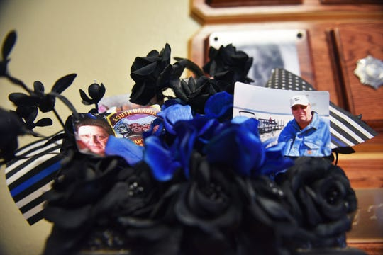 Photos and flowers of RJ Johnson are in the lobby of the South Dakota State Penitentiary before Rodney Berget is executed Monday, Oct. 29, in Sioux Falls.