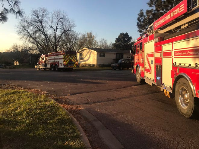 Fire crews standby near a standoff in the area of Pine Meadow Mobile Home Park in western Sioux Falls.