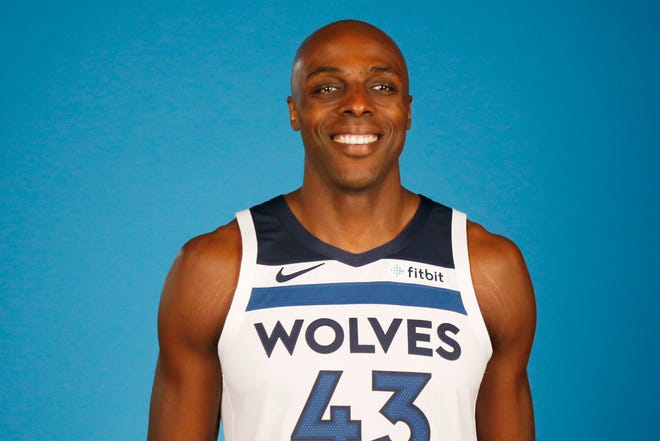 Minnesota Timberwolves' Anthony Tolliver poses for a photograph during the NBA basketball team's media day at Target Center, Monday, Sept. 24, 2018, in Minneapolis.