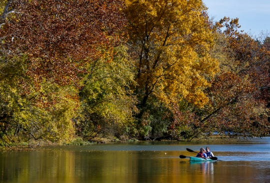 With some colorful fall trees as a backdrop, a couple paddles down the James River last fall.