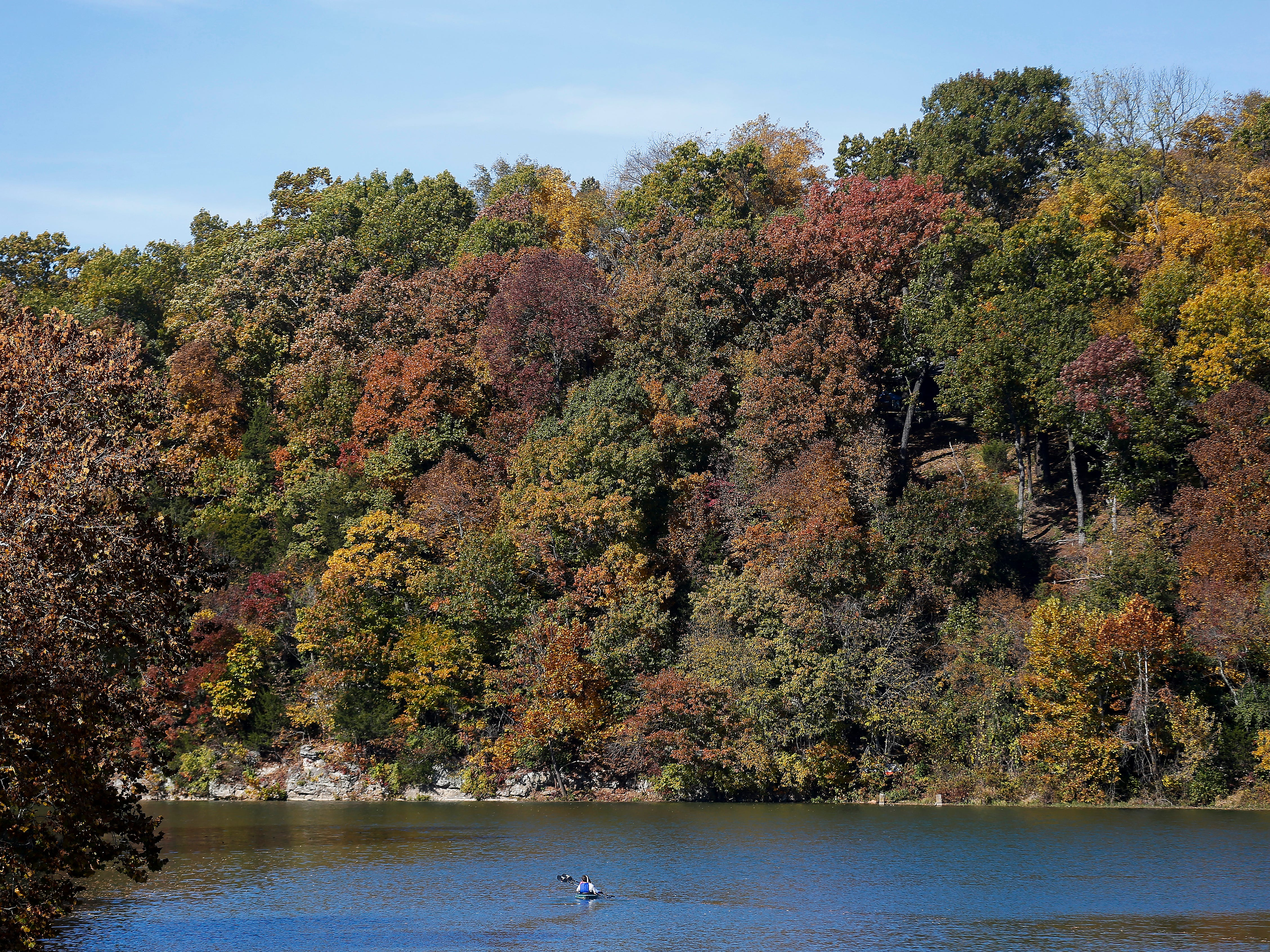 With some muted fall trees as a backdrop, a couple paddles down the James River on Monday, Oct. 29, 2018.