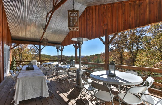 The reception hall also features an outdoor seating area with terrific views of the Ozark Mountains.