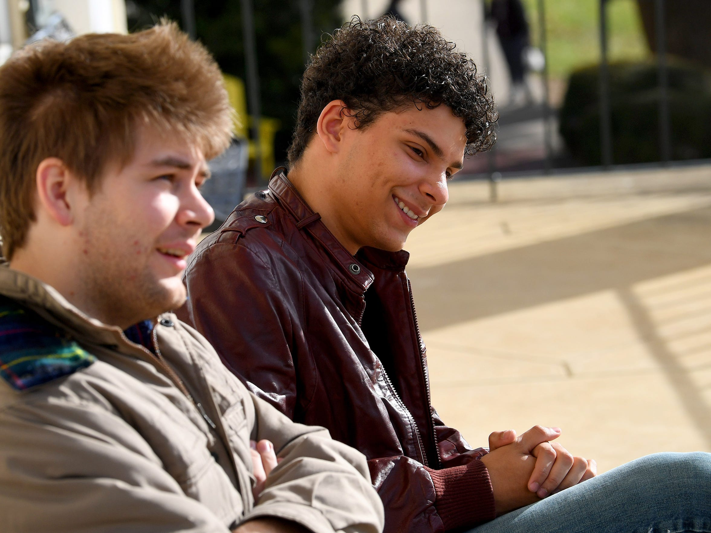 Junior Logan Davenport smiles as he listens to fellow junior Dominic Walker talk about an instance where female students confronted him for being a male attending the school. They were among the first eight males to live on campus after Mary Baldwin University went coed and talk during an interview on campus on October 25, 2018.