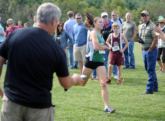 Wilson Memorial's Hannah Rose, shown here winning the 2012 Augusta County Invitational, was inducted into the school's athletic hall of fame.