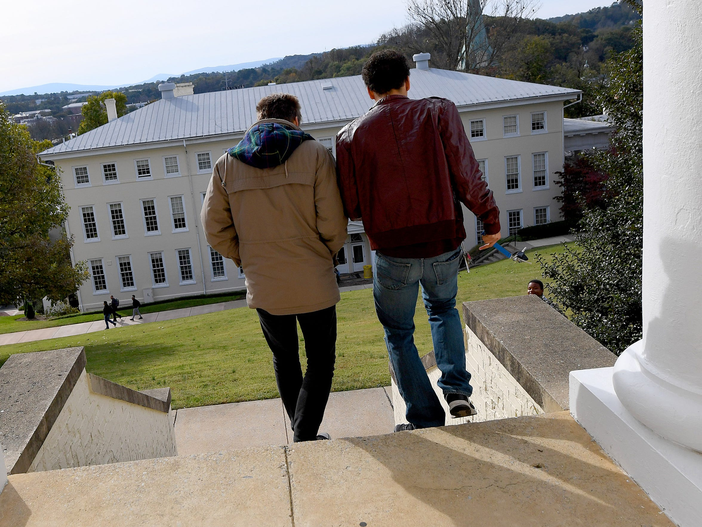 Juniors Dominic Walker and Logan Davenport of Mary Baldwin University descend the steps of Wenger Hall on campus on October 25, 2018.