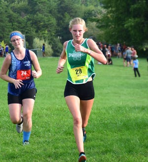 Wilson Memorial's Spencer Tuttle is coping with being on the sidelines for her senior cross country season after being diagnosed with stress fractures in her right leg.