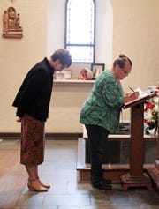 "A ""Book of Remembrance"" is placed at the front of St. John the Evangelist Catholic Church in Waynesboro on Sunday, Oct. 28, 2018 where congregation members can write down the names of deceased loved ones to be prayed for during the month of November as a way to honor them during All Saints' Day."
