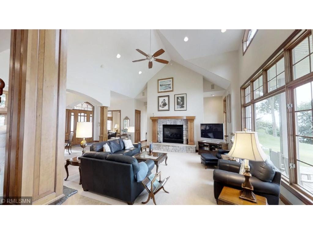 Sitting just inside the stately entry area, the great room– with its towering archways, high vaulted ceiling and grand stone fireplace –is the perfect place to greet guests.