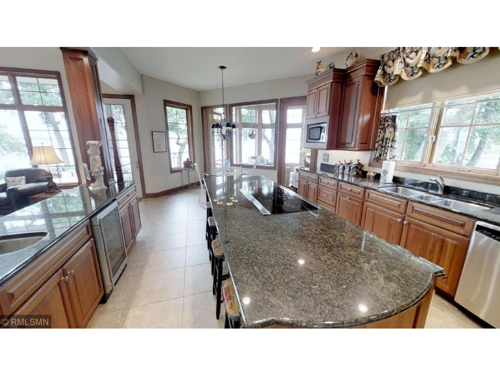 The kitchen connects to the great room across a granite-covered serving counter space.
