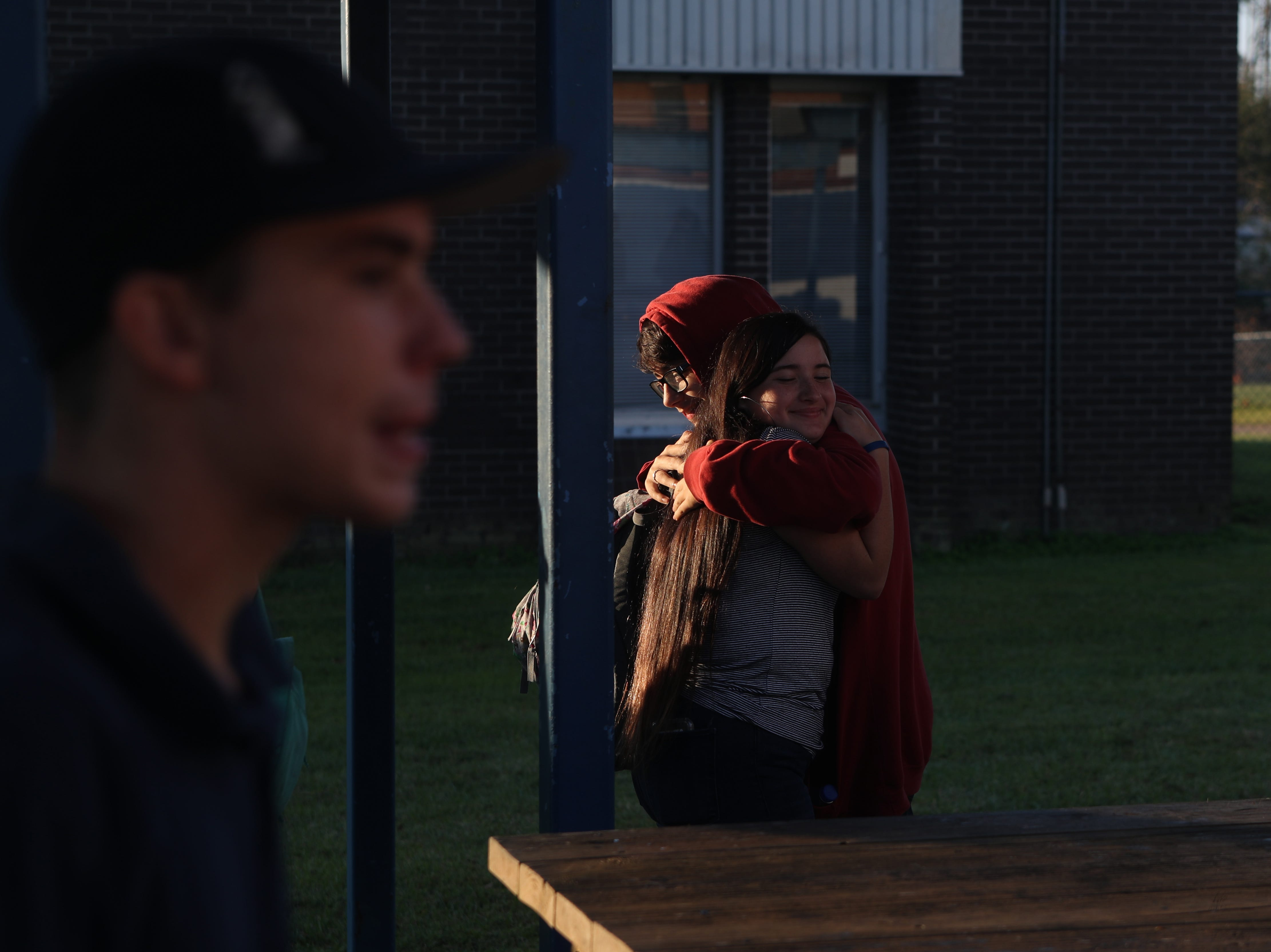 Sunshine Ayers, 14, and Hayden Cannady, 14, both freshmen, hug as they see each other in the courtyard of Sneads High School in Sneads, Fla. Monday, Oct. 29, 2018, before classes resume for the first time since Hurricane Michael hit the community three weeks ago.