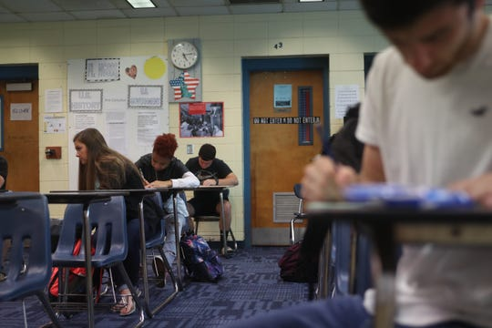 Students in Beth Sloan's homeroom class fill out Hurricane Michael information sheets at Sneads High School in Sneads, Fla. Monday, Oct. 29, 2018 as classes resume for the first time since Hurricane Michael hit the community three weeks ago.