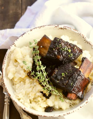 Easy Red Wine Braised Short Ribs are delicious served with mashed potatoes.