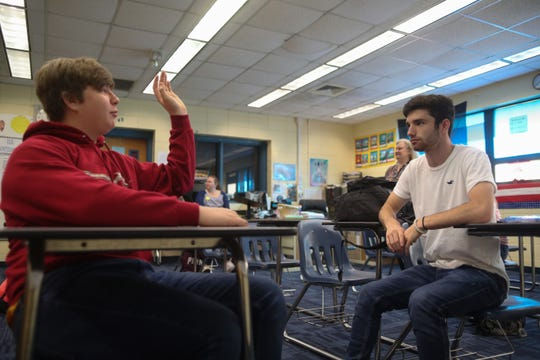 Hunter Wagner, 16, right, talks with Wyatt Wiggins, 17, both juniors, in Beth Sloan's homeroom at Sneads High School in Sneads, Fla. Monday, Oct. 29, 2018 as students returned to school for the first time since Hurricane Michael hit the community three weeks ago.
