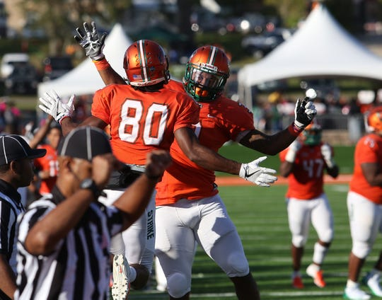 FAMU wide receiver Marcus Williams (80) celebrates a touchdown against Morgan State with Azende Rey.