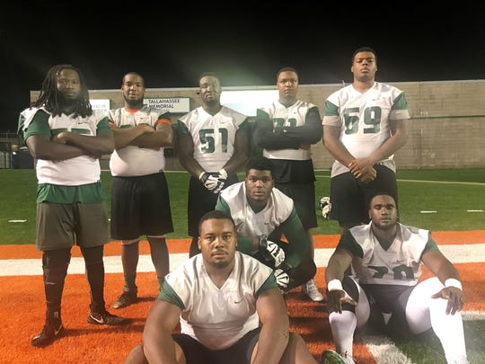 FAMU's offensive linemen have cleared a path for the team's top-tier passing and rushing stats. Back row from left to right: Dave Montas, Joshua Addison, Loubens Polinice, Myles Rouse and Patrick Dalton. Front row from left to right: Bryan Crawford, Andre Regis and Obinna Nwanko.