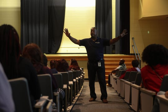Sneads High School Principal Ron Mitchell addresses the student body in the auditorium as they gather for the first time Monday, Oct. 29, 2018 since Hurricane Michael hit the community three weeks ago.