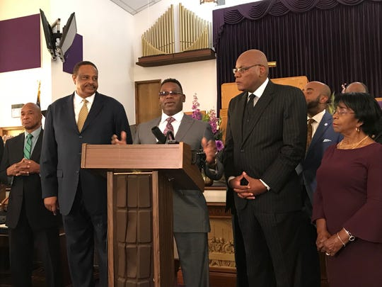 The Rev. Mark McMillan, center with Congressman Al Lawson and the Rev. R.B. Holmes(R). McMillan lost his voting rights with a grand theft conviction more than 20 years ago.