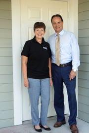 Indian River Habitat CEO Sheryl S. Vittitoe and The Moorings Yacht & Country Club CEO Craig Lopes.