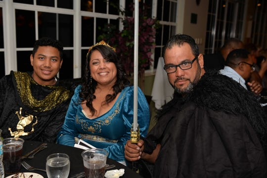 """Nelson Jr., left, Xelny and Nelson Rios at the E.N.D. It! Mystery Dinner Theater fundraiser """"A Wedding Knight To Remember."""""""