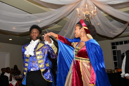 """Emmanuel Murray, left, and Sydney DuPree perform during the E.N.D. It! Mystery Dinner Theater fundraiser """"A Wedding Knight To Remember."""""""